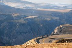 ** U.S. and Canadian Rockies Motorcycle Tour -- The Beartooth Highway grabs you and doesn't let go. After crossing a high plateau you descend along the edge of a mile-deep canyon toward Red Lodge. Charles Kuralt called the Beartooth the most scenic highway in America.
