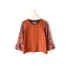 Teila 001  IDR 450.000  Loose Fit Comfy Soft Cotton Hand Stamped Batik Ruffled Sleeve Blouse    Length of Sleeve : approx. 54 cm    Length of Blouse : approx. 61 cm    Material Used : Hand Stamped Batik, Soft Cotton / Marmalade Cotton Fabric    Note : One button at the back for opening