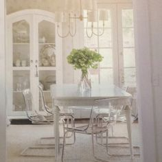 Southern living makeovers-love the white painted table with lucite chairs