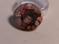 """Comic Book 1.5"""" Button// Cable carrying Hope, $1.00"""
