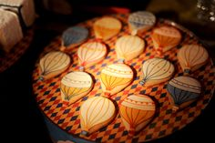 Beautiful hot air balloon cookies that could be used for many occasions and actually don't seem too difficult!