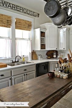 our vintage home love: Kitchen Updates ....gray cabinets below and cream above with warm wood accents. <3