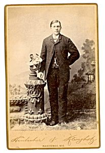 Young Man in Cabinet Photo