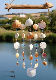 This beautiful eye catching wind chime is perfect for any patio, garden or home. The chimes hang from natural sea-worn driftwood collected from beaches in the Pacific Northwest. It features two brilliant blue geo agate slabs and beautiful crystal, ceramic beads. Agates are considered a semi-precious gemstone. A stone of strength, the agates most noticeable properties over all are balancing yin/yang energy, courage, healing and calming. Several different types of shells make up this…