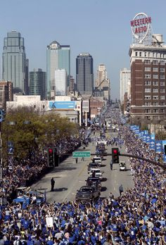 Kansas City Royals' team members parade through downtown Kansas City, Mo. as they celebrate the Royals winning baseball's World Series Tuesday, Nov. 3, 2015. The Royals beat the New York Mets in five games to win the championship.