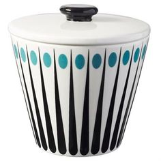 The pretty little sugar bowl Amanda from Superliving is made of bone china. It has a trendy and timeless design with black stripes and colored dots. Match the sugar bowl with the popular Amanda mugs and milk jug from Superliving.