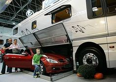 Luxury motorhome has a garage built in to store a car underneath. Now this is camping? Fiat 600, Smart Fortwo, Luxury Motorhomes, Prevost Motorhomes, Mercedes Slk, Camping Shelters, Luxury Bus, Luxury Glamping, House On Wheels