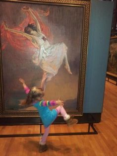 Funny Pictures: Little girl dances with painting