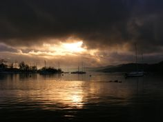 Sunset over Lake Windermere Lake Windermere is the largest natural lake in England.   It is in the county of Cumbria and entirely within the Lake District National Park.  The town center is about half a mile away from the lake.