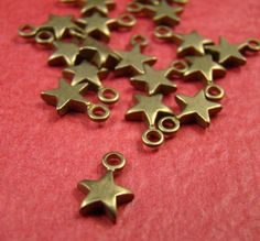 Antique Raw Brass Star Charm by shareliving. , via Etsy. Stones And Crystals, Crystal Beads, Belly Button Rings, Heart Ring, Brass, Charmed, Pendants, Antiques, Projects