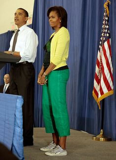 "U.S. President Barack Obama (L) delivers remarks with first lady Michelle Obama during a United We Serve event at Fort McNair June 25, 2009 in Washington, DC. Helping to fill 10,000 backpacks for children of military servicemen and women, the first family stuffed copies of ""The Lightning Thief,"" by Rick Riordan, and ""The Penderwicks,"" by Jeanne Birdsall into backpacks along with food items and a personal letter from the president and the first lady. June 25, 2009"