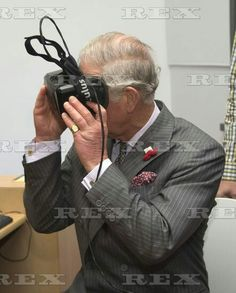 Prince Charles and Camilla Duchess of Cornwall visit to New Zealand - 05 Nov 2015 Prince Charles wearing a virtual reality headset at Animation Research in Dunedin 5 Nov 2015