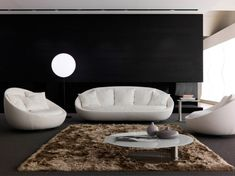 White Black Living Room with Elegant White Modern Couch plus Brown Fur Rug and Glass Top Round Table