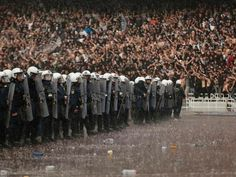 Athens, Greece - Policemen stand guard under heavy rain in front of PAOK Salonika fans before their Greek Cup soccer final against Panathinaikos at Athens' Olympic Stadium on April Anxiety Symptoms In Women, Crystal Palace Fc, Professional Football, Sports Stars, Football Fans, Photos Of The Week, Photojournalism, Real Madrid, Greece