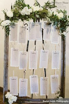 Rustic seating chart with olive branches, eucalyptus leaves and white tea roses by theflowerhouse.com