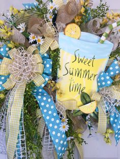 Whimsical Lemonade Blue and Yellow Mesh Spring and Summer Wreath by WilliamsFloral on Etsy https://www.etsy.com/listing/286370055/whimsical-lemonade-blue-and-yellow-mesh