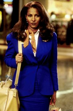 """""""Jackie Brown"""" (Pam Grier) effectively uses her cover as a flight attendent..."""