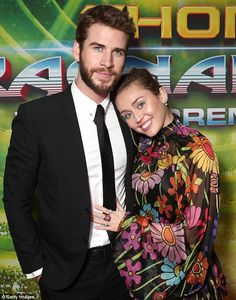 Smitten: Miley Cyrus, 24, supported her fiancé Liam Hemsworth, 27, on the red carpet for t...