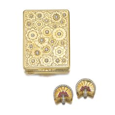 Gold and diamond compact and a pair of ruby and diamond brooches