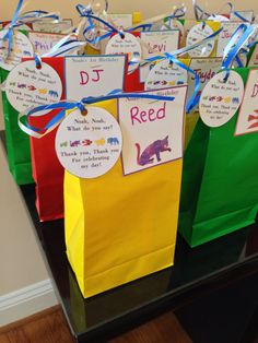 "Favor Bags for Birthday Party- brown bear birthday party. They contained a package of teddy Graham's, M&ms, and a custom-made bookmark with a ""brown bear"" on it!"