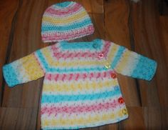 this lovely baby cardigan and hat set has been hand knitted and crocheted in a lovely soft acrylic multicolour colourchanging yarn in shades of blue,pink, yellow, red and white . It has been completed with 7 buttons. The cardigan is hand knitted and the hat has been crocheted.  newborn chest measures 16   All of my items are ready for next day despatch  All items are from a non smoking home  Please read my shop policies for more information x  Any questions please ask