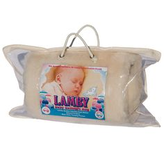 Lamby Baby Rug.  For over 50 years Lamby has been an icon in Australian Nurseries.  Made with the highest quality Australian wool, parents love the the natural softness of this lamb and sheepskin fleece to soothe and comfort babies and children. Lamby is a natural Australian fibre treated with non-toxic tanning agents. Australian Nursery, Nurseries, Paper Shopping Bag, Little Ones, Lamb, Parents, Babies, Pure Products, Wool