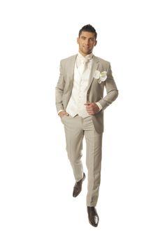 Veste et pantalon gris, gilet, chemise et cravate blanche ...
