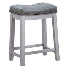 Crafted from wood, the Angel Line Cambridge 24 in. Padded Saddle Counter Stool with Nailhead Trim features a sturdy frame in your choice of available. Bar Counter, Counter Stools, Counter Space, Tall Bar Stools, High Top Tables, Luxury Home Furniture, Furniture Decor, Grey Cushions, Nailhead Trim