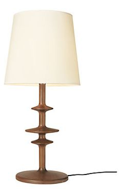 Our Parks table lamp is crafted from solid wood on the same machines that manufactured spools and bobbins in the mid-1850s. Paired with a white cotton shade, this beautiful and versatile lamp adds unexpected shape to any room in your home. The lamp's three-way switch offers multiple levels of light output, while a fabric-wrapped cord lends a vintage feel.