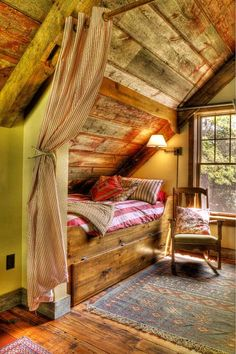 Rustic attic bedroom  like the color/tone of the wood, rustic feeling