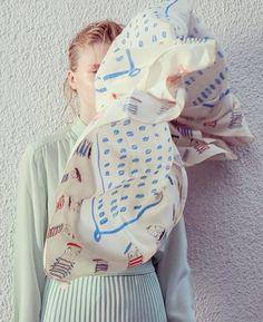 This silk Rumisu scarf is hand illustrated.