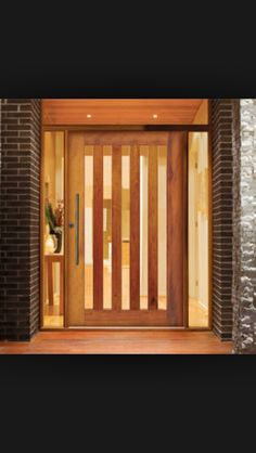 Timber pivot entrance door by Corinthian