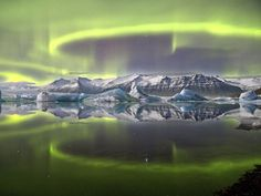 A vivid green aurora is reflected in the Jokulsrion Glacier lagoon at Vatnajokull National Park in Iceland. British photographer James Woodend won the title of Astronomy Photographer of the Year.