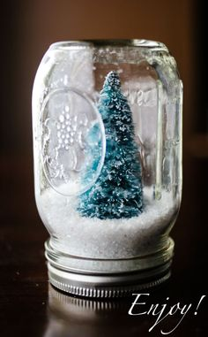 Homemade Snow Globe- super cute- could use other village pieces too