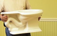 """Q: """"Four of the five toilets in my house overflow frequently. What should I do?"""""""