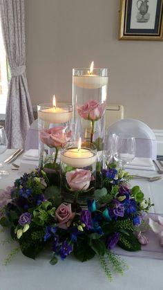 Submerged roses with flowers surrounding and floating candles