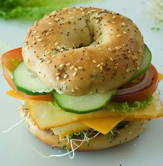 Recipe for  Veggie and Cheese Bagel Sandwich - I had veggies in my garden—cucumbers and tomatoes, along with some chives. It was a stifling hot day, so the coolness of the sandwich was just the ticket for us desperate, hungry women. The other three ladies sainted me instantly. It was a real kick!