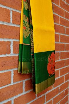 #yellow saree with bottle green pallu gives a pleasant look ever#