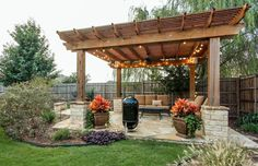 Large pergola with string lights above flagstone patio