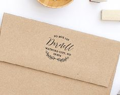 This return address stamp is the perfect gift for weddings, housewarming, or just because! Use it to stamp envelopes, invitations, cards, books, or whatever else you need. The wood mount stamp imprint measures approximately 1.25 x 2.5 inches and the self inking is just slightly smaller.  Or selected the wood mounted option and stamp until your hearts content in any color you wish! Need Ink for your wood mounted stamp? You can add it to your order here: https://www.etsy.com/shop...