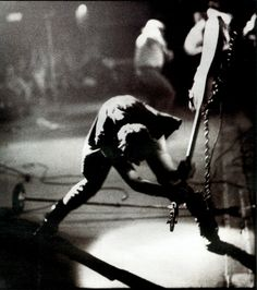 Paul Simonon, bassist of The Clash, smashes his Fender Precision bass against the stage at The Palladium.New York City on 21st September, 1979. Photographer Pennie Smith