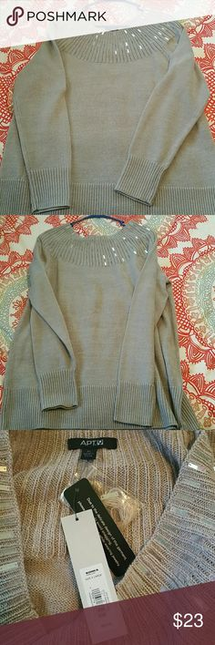 Beige bling sweater Brand new with tags, beautiful sweater with shimmering gems around the front and back. Bought it for the holidays, never wore it! Larger scoop neck style. Beige, taupe colored. Size XL. Try to size. Apt. 9 Sweaters Crew & Scoop Necks