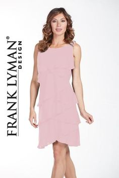 Flattering tiered ruffle dress with embellished shoulder. Proudly Made in Canada