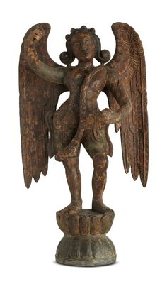 This wooden figurine of a male angel is the result of an eclectic intermingling of multiple cultures. The treatment of the hair and the wings recalls images of angels in western traditions. The body is, however, depicted in tribhanga – the stance used in Indian sculpture, with the body curving at the waist, neck, and hip to create a gentle S curve. Such figurines are common in regions of Tamil Nadu, where Dutch, Portuguese, and British influences had been assimilated.