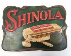"Vintage Shinola store display metal sign. Depicts Shinola products. Reads ""SHINOLA"" in red lettering and on the lower left ""THE WONDERFUL SHOE POLISH"" in light brown lettering. Condition: There are so"