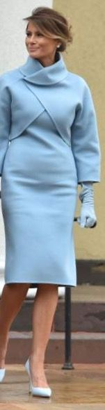Melania Trump inauguration dress. Melania in powder blue wool dress with matching jacket, light blue gloves and light blue shoes.