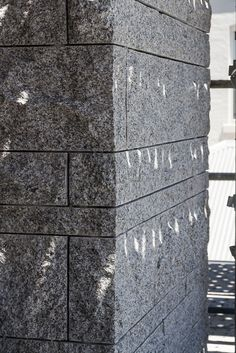 Solid stone corner detail of granite stone masonry going up on the facade at Armadale Residence by B.E Architecture