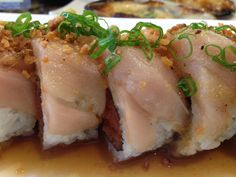 the Ken Special roll @ Matsu spicy tuna inside and albacore on top with ponzu, fried garlic and green onions