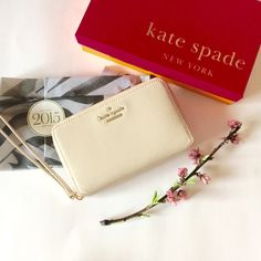 "Kate spade leather Tech Wallet/Wristlet New without tags. Comes with KS box. Makes a perfect gift . KS Cedar street Laurie Tech Wristlet in creme color. Bought it at Kate Spade Boutique and still in website for full price. Material: leather with matching trim, 14K light gold plated hardware, zip around wristlet, interior cell-phone and slip pockets, 7 card slots, 2 billfolds, slide pocket. Measurements: 4""H x 6.5""W. kate spade Bags Wallets"