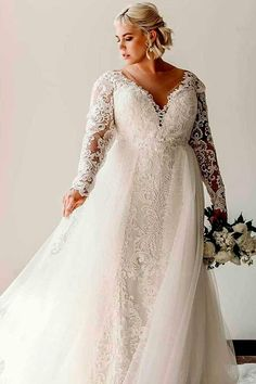 Impressive plus size full lace mermaid wedding dress with long lace sleeves and . - Impressive plus size full lace mermaid wedding dress with long lace sleeves and gorgeous flowy tulle second look ceremony skirt. Studio Levana Source by - Western Wedding Dresses, Long Wedding Dresses, Designer Wedding Dresses, Bridal Dresses, Plus Size Wedding Dresses With Sleeves, Plus Size Wedding Gowns, Wedding Dresses For Curvy Women, Plus Size Brides, Fru Fru
